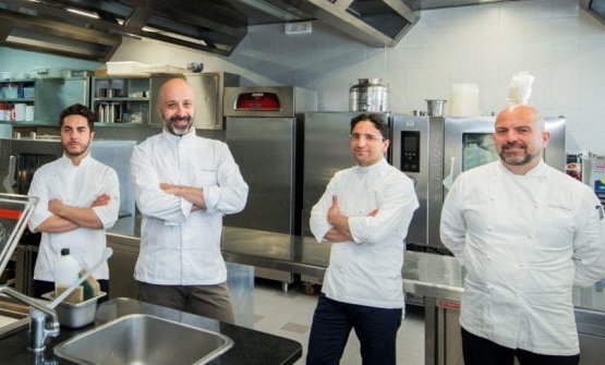 In the middle, Niko Romito and his resident chef in Beijing Claudio Catino (second from the right)