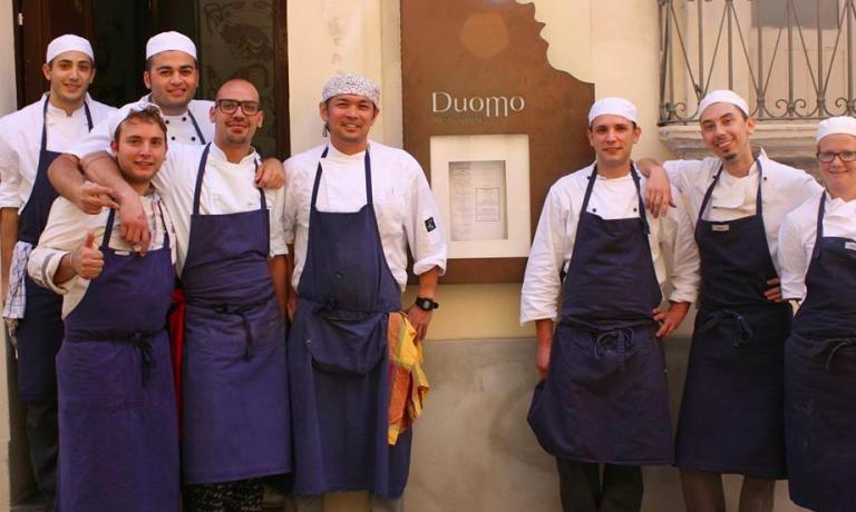 Peppe Cannistrà in the photo is the only one without a beret: he's Sultano's sous chef at Duomo, and will be the executive chef at I Banchi