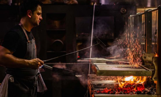 Lennox Hastie by the grill at Firedoor, in Sydney, Australia (photo from firedoor.com.au)