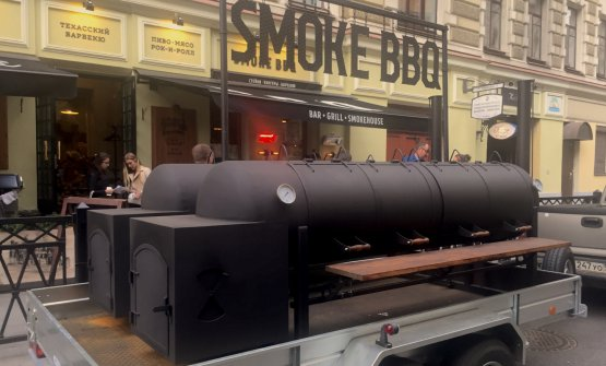 A mega-barbecue on wheels, in front of restaurant Smoke Bbq, in Ulitsa Rubinshteyna, a popular street at night