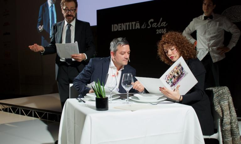 Giulia Fidone, in a photo taken on the stage of Identità Milano 2015 during Il signore non è servito, a show put on by association Noi di sala, with actor Marco Giallini as the protagonist. Giulia works in the dining room at Jardin de Russie, inside the Hotel de Russie in Via del Babuino in Rome