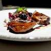 Pigeon in three styles of cooking. In this case leg confit with blackberries and hazelnut sauce