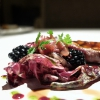 Pigeon tartare on radicchio, compote of onions and blackberries