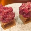 Cubo de wagyu. A cube of crispy potato chips topped with a wagyu tartare seasoned with oil, salt, Dijon mustard, eggs and pepper. A magnificent tapa 2 cm wide which recalls Piedmontese traditional hand chopped raw meat