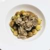 Potato spheres, black garlic, Grana Padano Dop Riserva, sea urchins and truffle by Cristina Bowerman