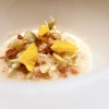 "Jerusalem artichoke ""risotto"", tuna bottarga and horseradish. There are many fake risottos available, such as the one with celeriac by Yoji Tokuyoshi and Salvatore Tassa or the vegetable one by Pedro Subijana. This is really perfect, with cream of Parmigiano and artichoke petals"