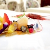 "Our ""raw"" catalana: red prawn with oil and balsamic vinegar, langoustine, prawns, squilla mantis carpaccio with pomegranate, raspberry, blueberries, radish, yellow tomato and orange"
