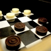 The final chequers: the white pawns have white chocolate, the black ones have truffle