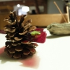 Four dishes called Miniature Wild. The first: Vele di Marzemino with pesto and pine sprouts, served on a pine cone