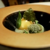 L'uovo delle Dolomiti: egg on a cream of plantain, candied beech, white lichen, porcini reduction