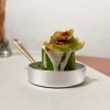Courgette roll with potatoes from Sila, egg yolk, mustard sauce, cream of blue cheese and anchovy and courgette flower