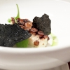 Seared octopus, cream of almonds, rocket salad water, wafer of potatoes from Sila with squid ink