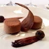 Chocolate mousse, cocoa biscuit, praline and nuts