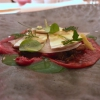 Carpaccio with dehydrated watermelon, ovuli, Parmigiano, lettuce leaves and lettuce cream