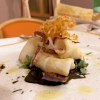 Calamari with fermented garlic, with celeriac chips. A remarkable use of herbs: thyme, marjoram...
