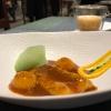 Langostino en suquet, with potato gnocchi, air of potatoes, saffron cream and potato. In the background, Capucchino de suquet