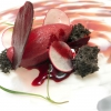 Remolacha y rabanitos, beetroot and radishes: blackberry ice cream, radish in osmosis with Campari, sponge of black sesame, crystals of beetroot and fennel sprouts