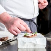 Rossi chooses a lamb tataki quickly cooked after marinating it in Earl Grey tea (which is aromatised with bergamot), served on a sauce made with barbecued prawn bisque with ricotta made with goat and cow's milk curdled with bergamot and salt, and a wafer of crespigno